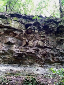 Natural rocky outcrop showing geological features of the area